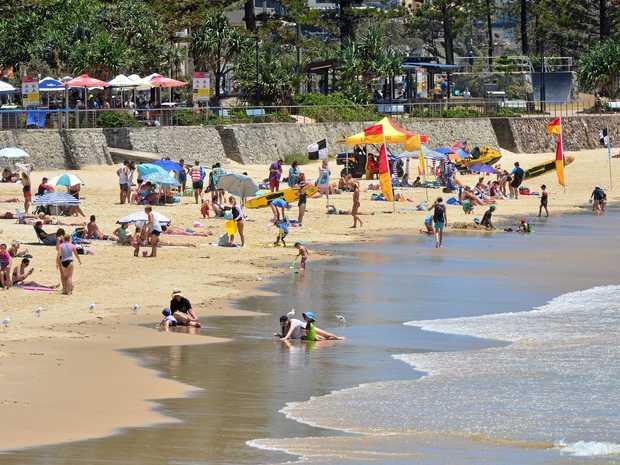 People escape the heat at Alexandra Headland