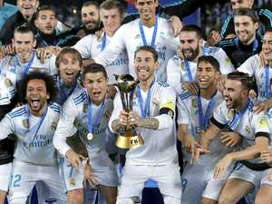 Real Madrid's Sergio Ramos holds the trophy after winning the Club World Cup final