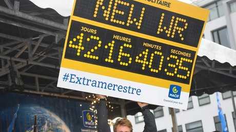 French skipper Francois Gabart celebrates his world record.