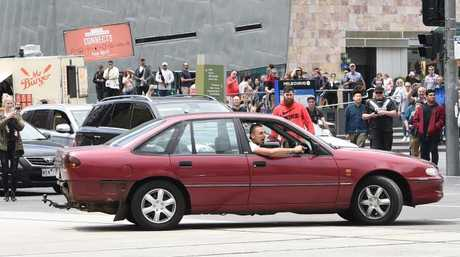 The car at Federation Square just before it drove into Bourke St. Picture: Tony Gough