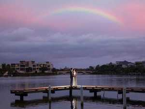 Couple says 'I do' under rainbow