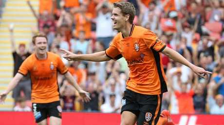 Thomas Kristensen celebrates a goal for Brisbane Roar last year. Picture: Jono Searle.