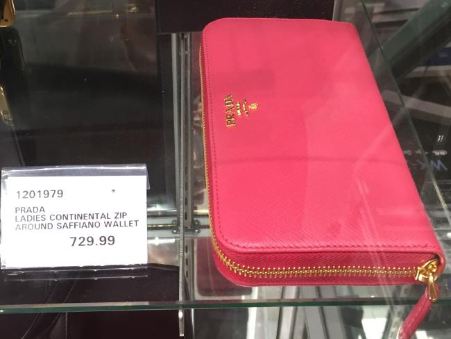 The hot pink Prada wallet.