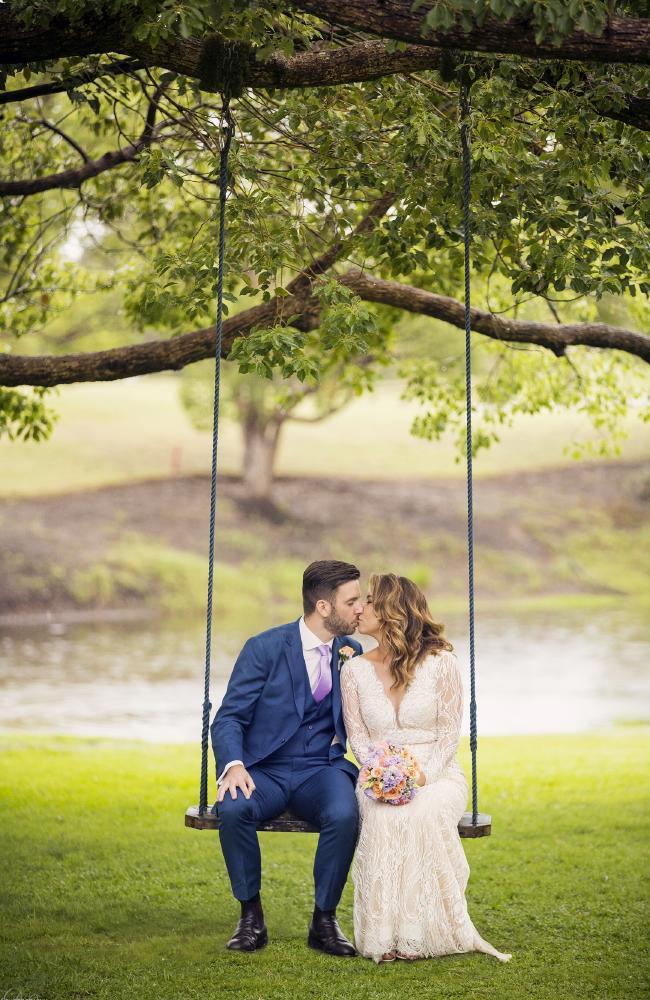 Amber and David say 'I do' under a rainbow. Photo: DK Photography