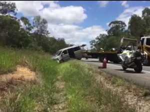 Van flips in crash at Bells Bridge