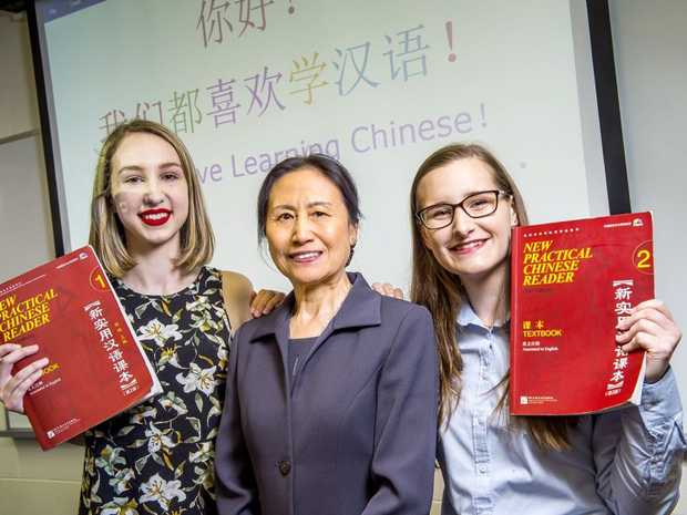 USQ Chinese Studies lecturer Yan Zhao (centre) with students Courtney Cook and Ruby Weeks.