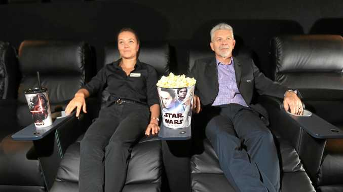 Hoyts Tweed City's duty manager Georgie Oram and manager Glenn Brooker try out the new reclining cinema seats.