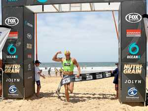 ON THE RISE: Matt Bevilacqua crosses the line to win the Nutri- Grain Ironman round at North Wollongong.