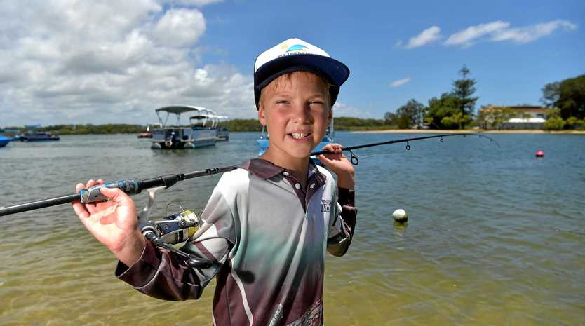 8 year old Zayne McDonald caught a 1.8m marlin while fishing with his dad off Mooloolaba.Zayne is pictured with the rod he used to catch the fish.