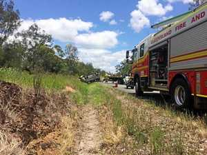 Van flips in truck crash on Bruce Hwy