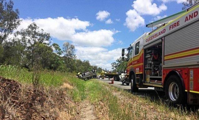 A van flipped on its roof in a crash with a truck on the Bruce Hwy north of Gympie this morning.