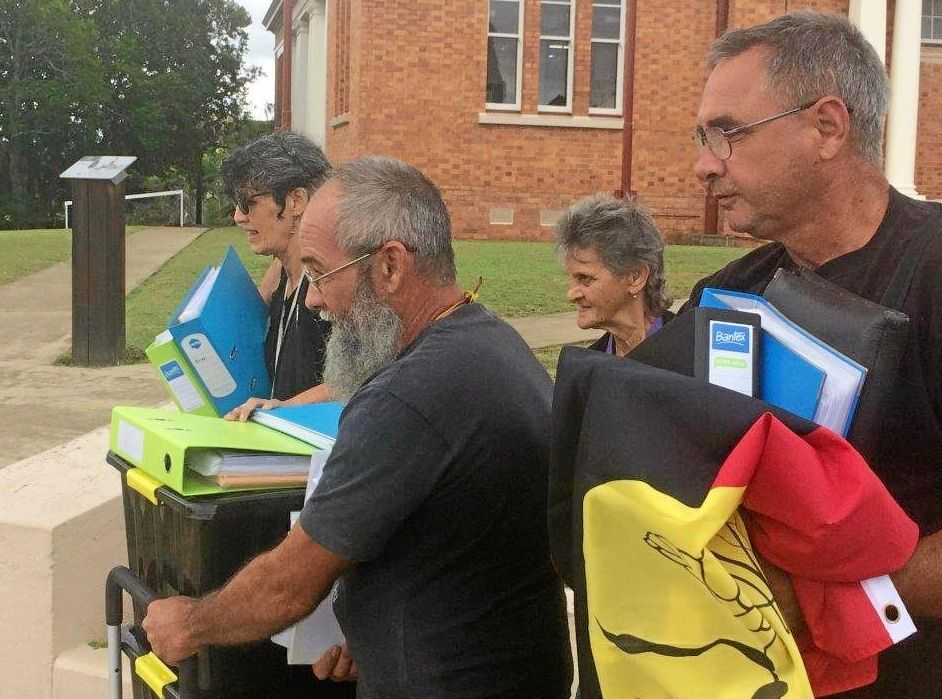 LAND RIGHTS: Activist Wit-boooka with co-accused and supporters as their claim to own Gympie region goes through the courts.