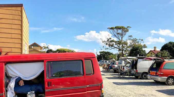 UNWELCOME RETURN: Just a few of the 18 vanpackers making themselves at home at 8.45am on Monday December 18 in the Rails Carpark at Byron Bay.