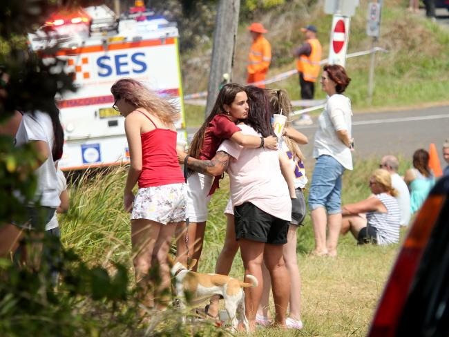 The community gathering to console each other. Pictures: Nathan Edwards