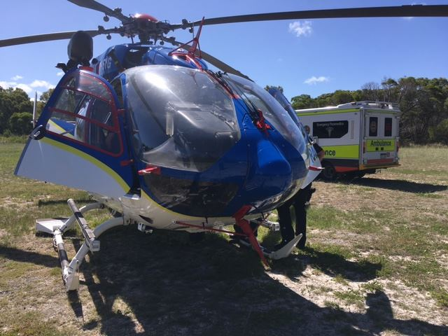CLOSE CALL: The LifeFlight helicopter prepares to transport the 3-year-old boy to Bundaberg Hospital from 1770 yesterday.