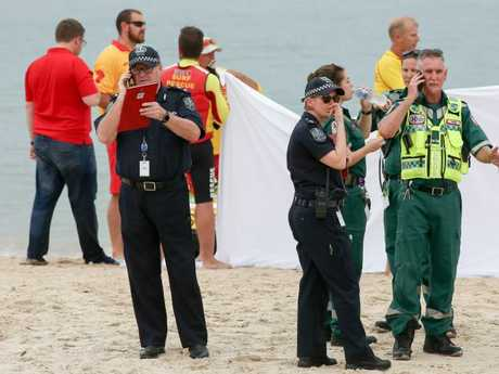 Police and paramedics at Glenelg beach. Picture: AAP / Russell Millard
