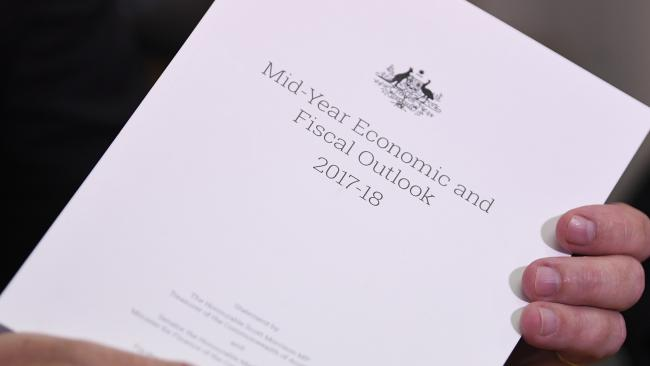 Australian Federal Treasurer Scott Morrison holds the Midyear Economic and Fiscal Outlook 2017/18 in his hands. Picture: AAP Image/Lukas Coch