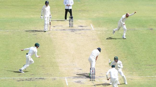 Australia's Nathan Lyon (far right) celebrates as his captain Steve Smith (bottom centre) after catching England's captain Joe Root.