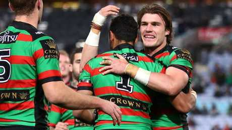 Angus Crichton celebrates a South Sydney try.
