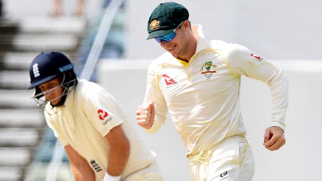 A tale of two captains: England's Joe Root (L) reacts after being caught, while Australia's Steve Smith smiles.