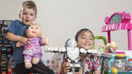 Khue Ta, 8, and Archer Boddington, 2, play with some of the gifts. Picture: Jason Edwards