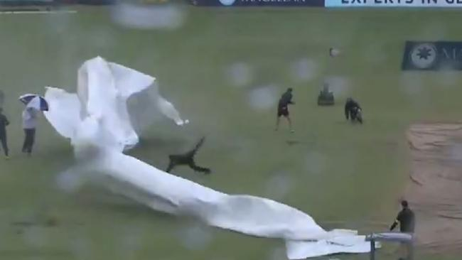 Wild weather at the WACA as groundsman gets wiped out.