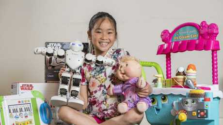 Khue Ta, 8, with presents from the Christmas gift guide. Picture: Jason Edwards
