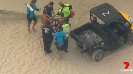 Paramedics attend to the man on Bondi Beach. Source: 7 NEWS