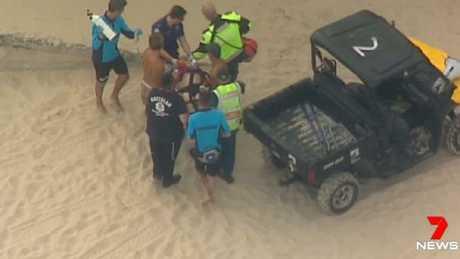 Paramedics attend to the man on Bondi Beach. Source: 7 NEWS