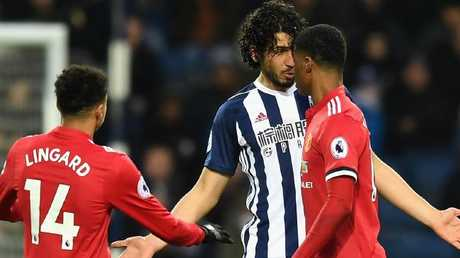 Ahmed El-Sayed Hegazi of West Bromwich Albion argues with Marcus Rashford.
