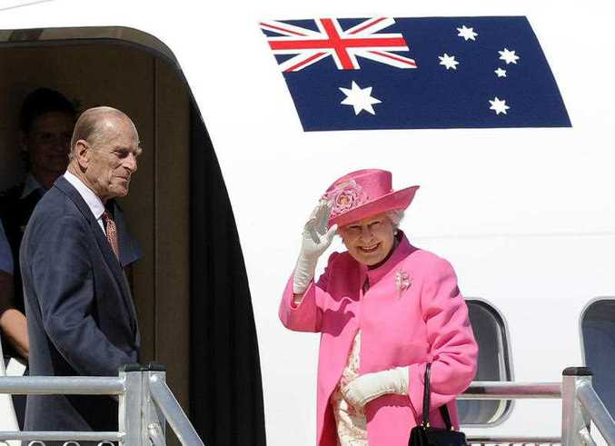 Britain's Queen Elizabeth II, right, and her husband Prince Philip board a plane flying to Perth from Melbourne airport. FILE PHOTO