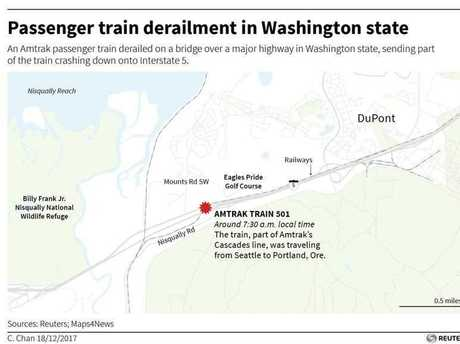 An Amtrak passenger train derailed on a bridge over a major highway in Washington state, sending part of the train crashing down onto Interstate 5.