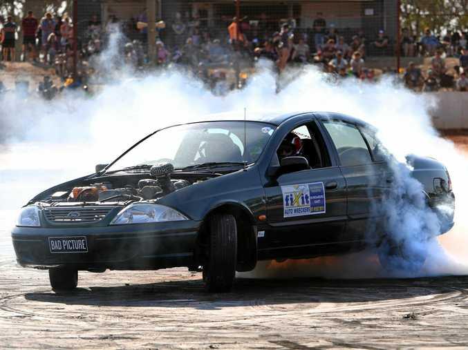 SMOKING: Brody Burgess slides round the skid pad at Carina Speedway Bundy Burnouts.