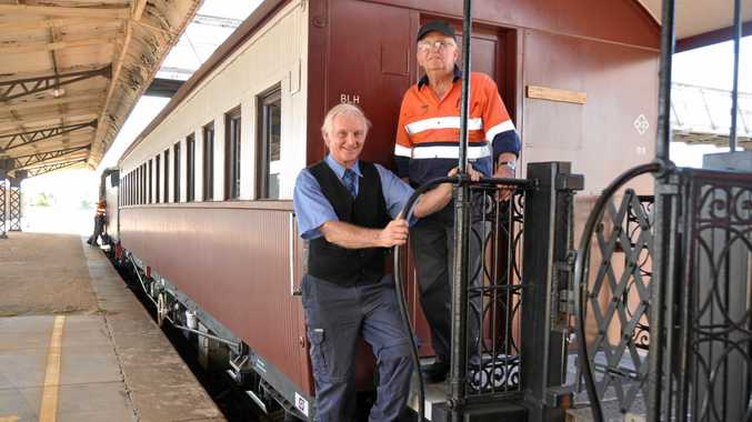 GOING STRONG: Southern Downs Steam Railway secretary Bob Amos and President Peter Gregory next to the treasured piece of history.