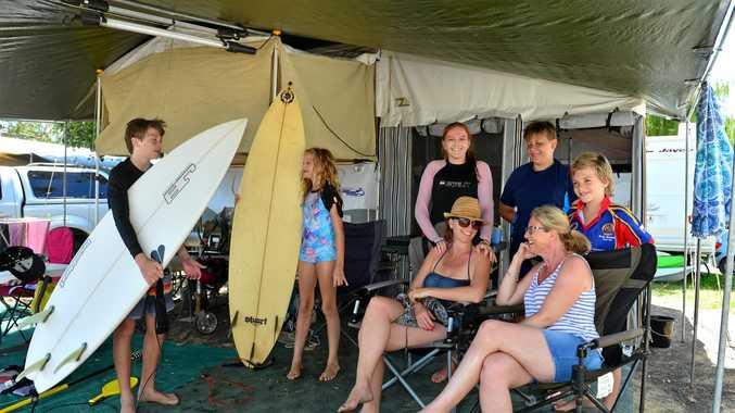 Ben Walsh, 15, Poppy Walsh, 11, Phoebe Murray, 12, Belinda Murray, Tyler Sly, 13, Hannah May and Hunter Walsh, 9, catch up at Cotton Tree Holiday Park.