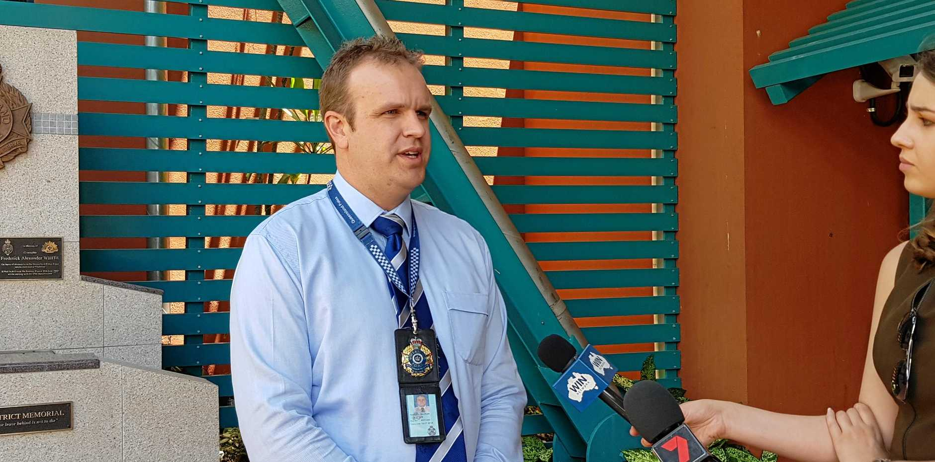 HUNTING SUSPECT: Detective Acting Senior Sergeant Nathan Lucy addresses the media outside Gladstone Police Station.