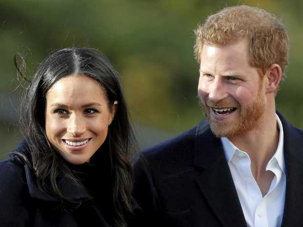 Britain's Prince Harry and his fiancee Meghan Markle arrive at Nottingham Academy in Nottingham, England.