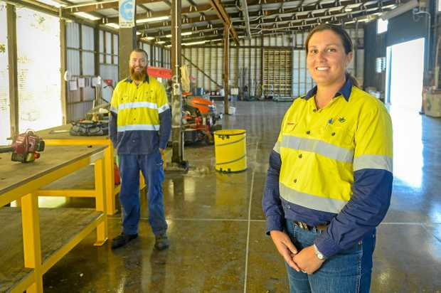 RENOVATION: Gladstone Ports Corporation landscapers Grant Haimi and Amy Wilkinson in the newly revamped workshop on Flinders Pde, with water, power and a dedicated office and maintenance area.