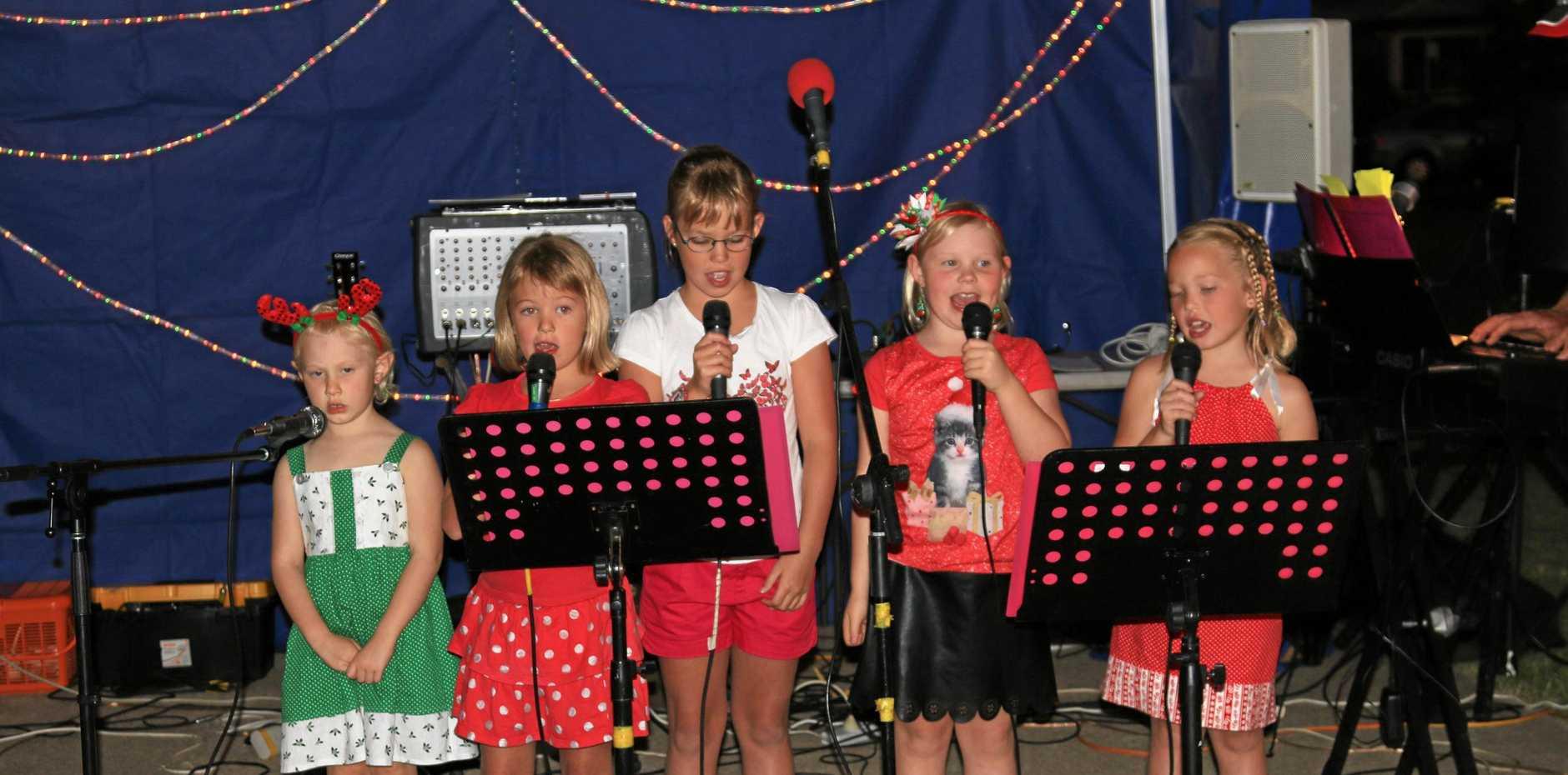 ABOVE: The Petersen Angels singing Christmas carols.