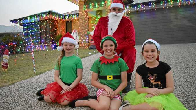 Filled with Christmas spirit are Ebony Williams, Mikayla O'Neill and Tattzianna Minchell, with Nick Minchell (Santa).