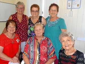 Volunteers celebrate with an eye to the future