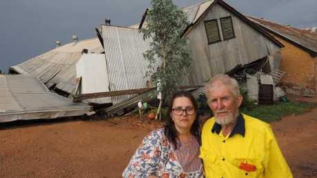 Historic Chateau Mildura owners Lance and Marina Milne with their collapsed shed. Picture: Glenn Milne