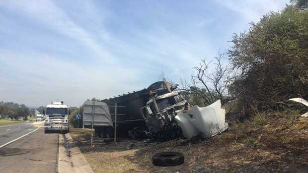 A truck has been gutted by fire after a two vehicle crash on the Hume Highway in South West Sydney. Picture: Live Traffic Sydney