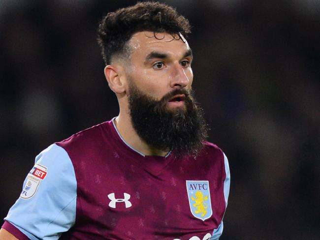 Mile Jedinak playing for Aston Villa vs Derby County.