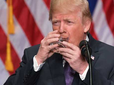 Donald Trump takes a sip of water while speaking about his national security strategy. Picture: AFP/Mandel Ngan