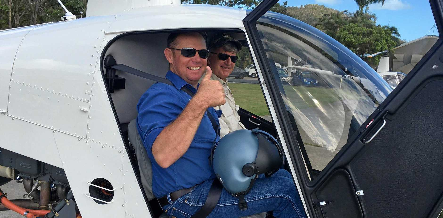 FLYING COLOURS: Cattle station manager Chris Morrow passed his pilot's test with HeliBiz owner Des Davey.