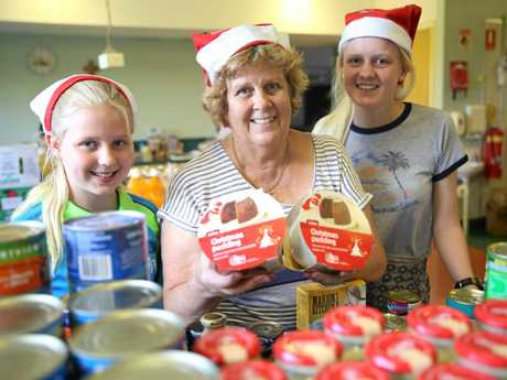 Rhianna Jordan, Desley Neal and Taylah Jordan lent their time and effort to help pack the food hampers which will go out to Gympie's less fortunate.