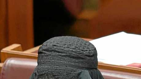 Pauline Hanson wears a burqa during Senate Question Time at Parliament House in August.