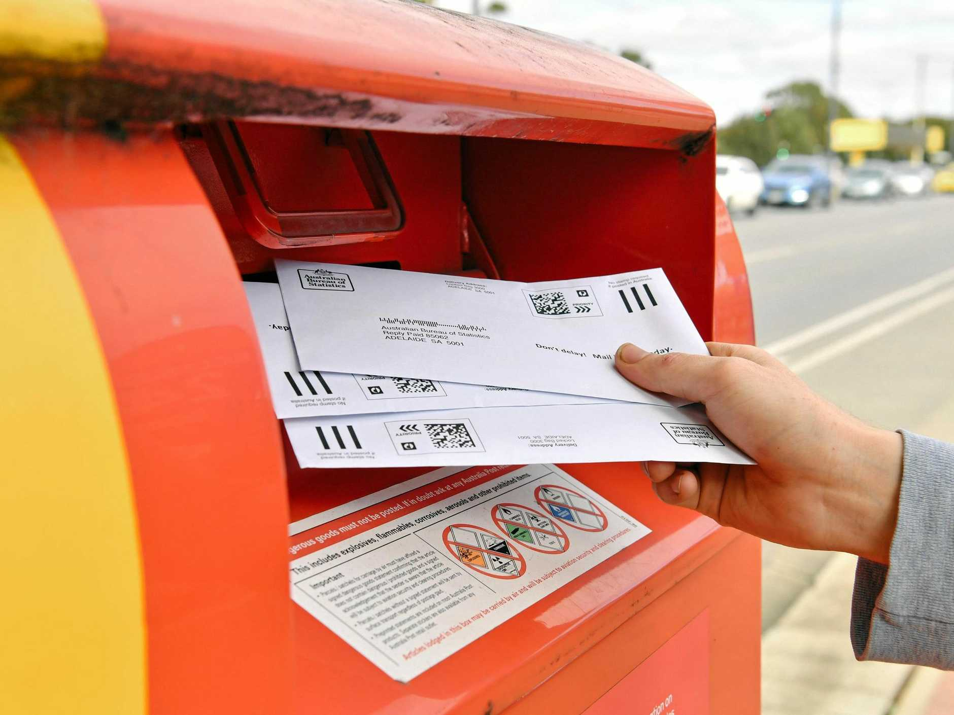 Sealed envelopes from the Marriage Law Postal Survey are seen being posted in Adelaide, Tuesday, September 19, 2017. (AAP Image/Morgan Sette)
