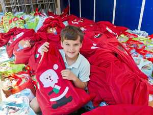 Young boy gives 200 Christmas hampers to city's homeless